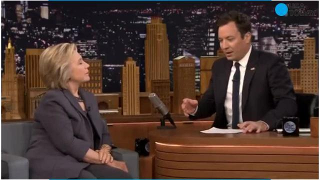 Jimmy Fallon puts on surgical mask to greet Hillary Clinton