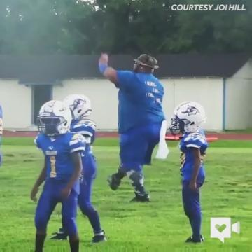 This dancing pee wee coach knows exactly how to get his kids excited for the game!