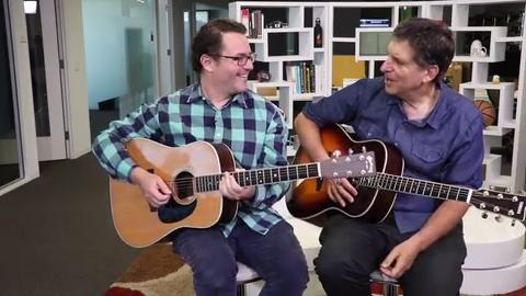 """Reid Genauer performs his composition """"Speculator"""" in the USA TODAY Los Angeles bureau, accompanied by Jefferson Graham on guitar"""