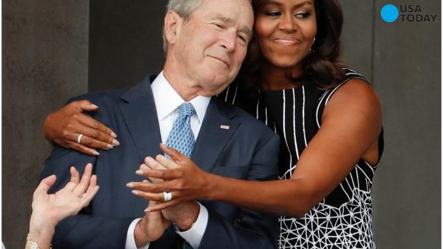 Saturday's dedication of the National Museum of African-American History and Culture brought together the president who signed into law the funding for the museum and the president who was in office during its completion. But the photo of the day was of former President George W. Bush and First Lady Michelle Obama.