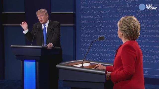 Hillary Clinton and Donald Trump shake hands during