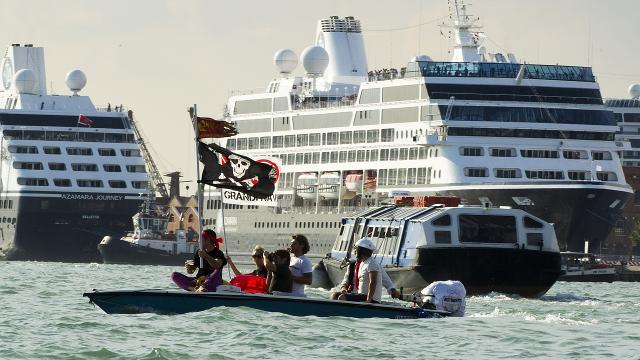 Venice locats are trying to save the Italian city from damage that huge cruise liners can cause.y