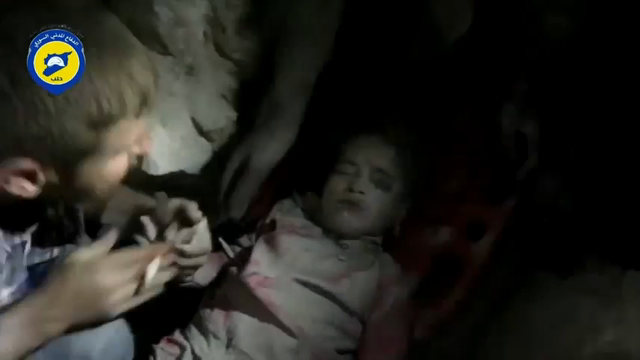 Footage released on Wednesday by Syrian Civil Defense in Aleppo city shows rescue workers pulling a little girl from under the rubble of a building in al-Shaar neighborhood in rebel-held eastern Aleppo. (Sept. 30)