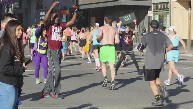 The Free Hugs guy spreads kindness from coast to coast