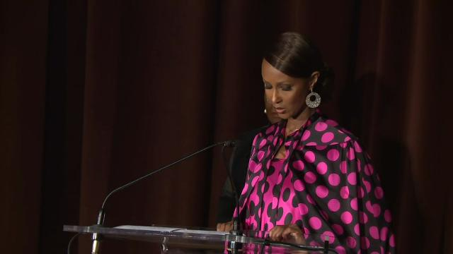Model Iman gets emotional talking about her late husband, David Bowie, while accepting an award at gala for Save the Children. (Oct. 25)