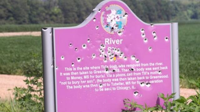 The historical sign marking where Emmett Till's body was found in the Tallahatchie River in 1955 has been riddled with bullets.