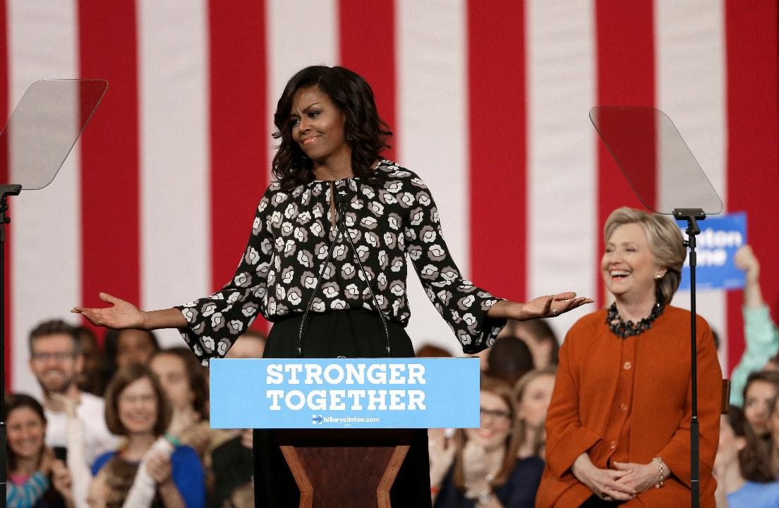 Support for 'my girl' Clinton is personal, Mrs. Obama says