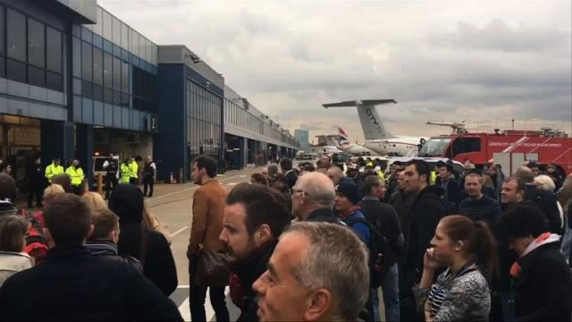 "Hundreds of passengers and staff are evacuated from London City airport following a ""chemical incident"" that left 26 travellers feeling unwell and shut down flights in and out of the hub. Video provided by AFP"