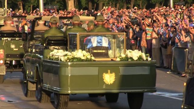 A military jeep carries the ashes of Fidel Castro along streets lined with hundreds of thousands of flag-waving Cubans in Havana, starting a four-day journey to his final resting place across the island. Video provided by AFP