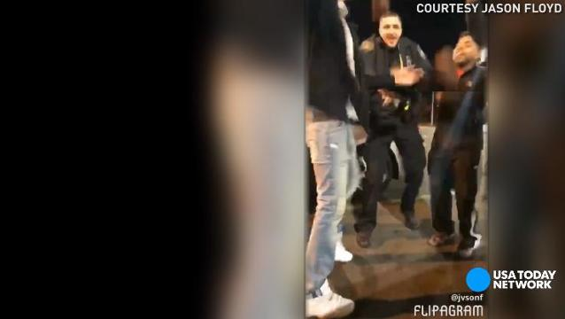 Cool cop busts a move with teens in viral video