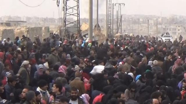 Thousands flee rebel-held areas of Aleppo