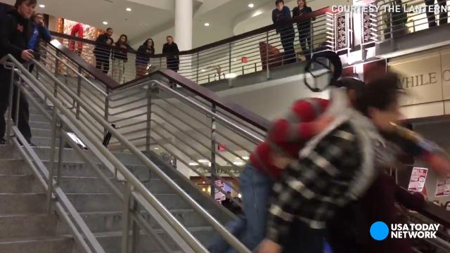 Man tackles anti-Trump protester down flight of steps