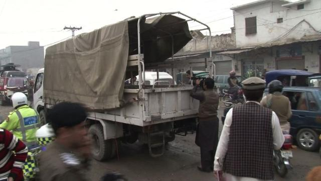 77132177a79 ... truck on a crowded city street kills three security personnel in  Pakistan s troubled northwest