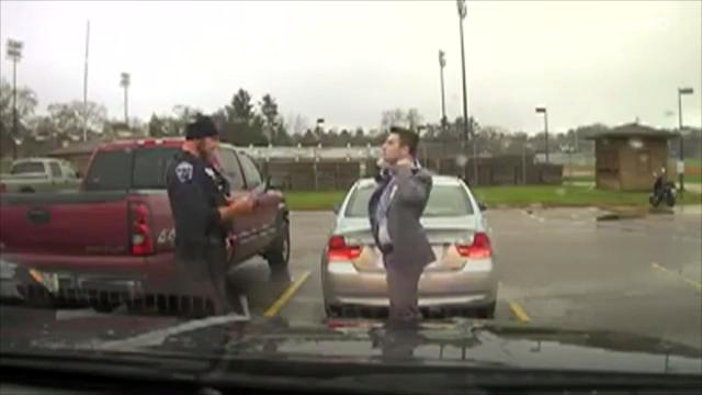 Officer Helps UW Student Tie a Necktie During a Traffic Stop