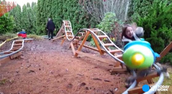Awesome dad builds backyard theme park