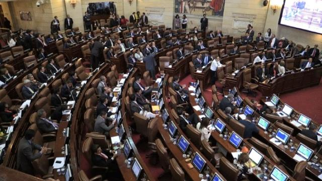 Colombia's Congress has unanimously approved a peace deal with FARC guerrillas to end more than a half-century of civil war, lawmakers say. Video provided by AFP