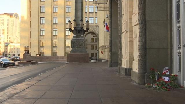 Russians laid flowers outside the Foreign Ministry building in Moscow on Tuesday to honor the Russian Ambassador to Turkey, Andrei Karlov. (Dec. 20)
