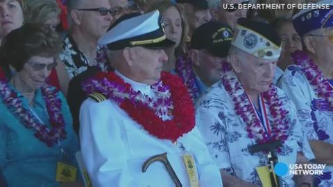 A gathering at Pearl Harbor fell silent to honor those that died on December 7, 1941.