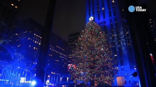 The 2016 Rockefeller Center Christmas tree lights up New York's dreary skies