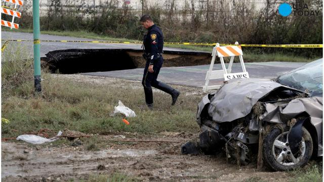 Texas sinkhole swallows two cars, killing a sheriff's deputy