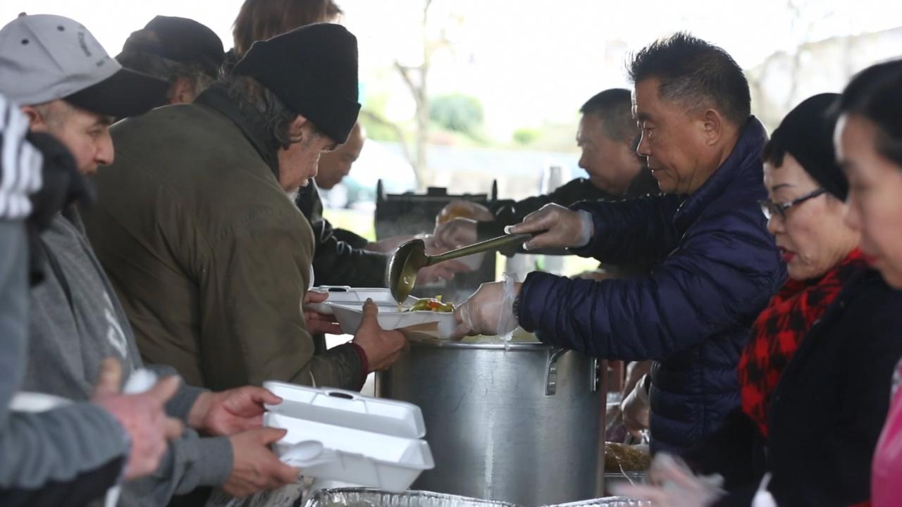 Image result for korean couple feed the homeless