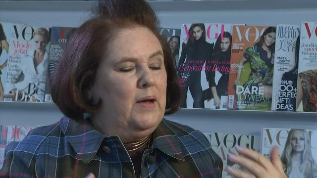 Vogue's International Editor Suzy Menkes reveals the origin of her distinctive hairstyle and discusses why she doesn't wear black clothes. (Dec. 9)