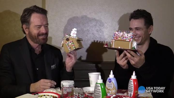 What better way for Bryan Cranston and James Franco to show off their holiday spirit than by building gingerbread houses?
