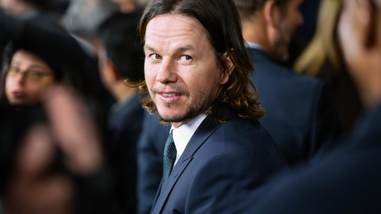 The 'Patriots Day' star had to grow out a mane for 'Transformers 5' and he's not happy about it.
