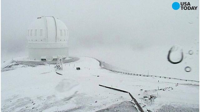 With a winter storm warning in effect through Saturday, the summits of Hawaii's Big Island could get more than two feet of snow.