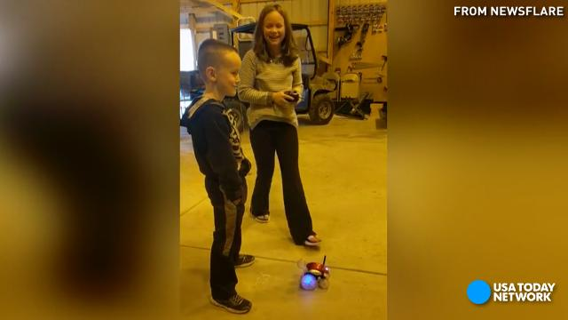 Girl pulls out little brother's tooth using remote-control car