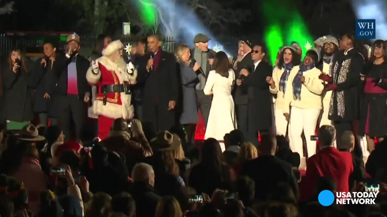 Jingle all the way: Obama carols with Santa