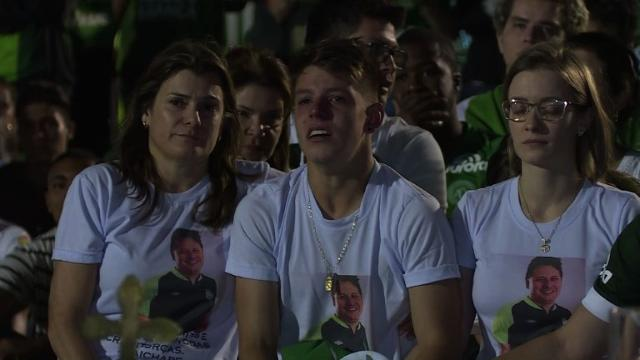 Fans of Brazil's Chapecoense football club, whose team was wiped out in a Colombian air crash, cram into the home stadium for tearful prayers around the empty pitch. Video provided by AFP