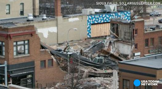 A construction worker was killed and a woman rescued after a building collapsed during remodeling in Sioux Falls, South Dakota. A dog was also rescued from the rubble.