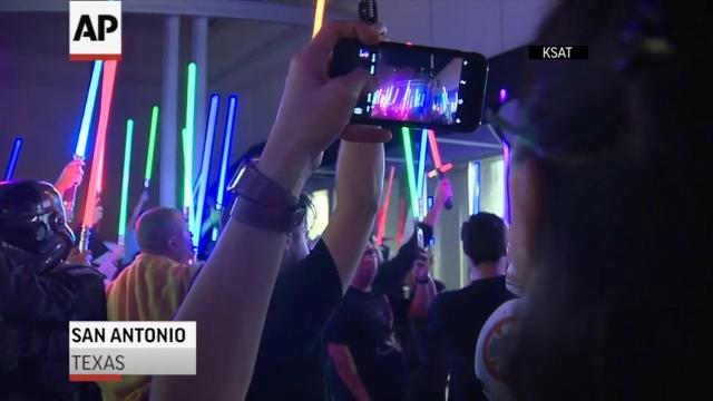 Light sabers held high at Carrie Fisher vigils