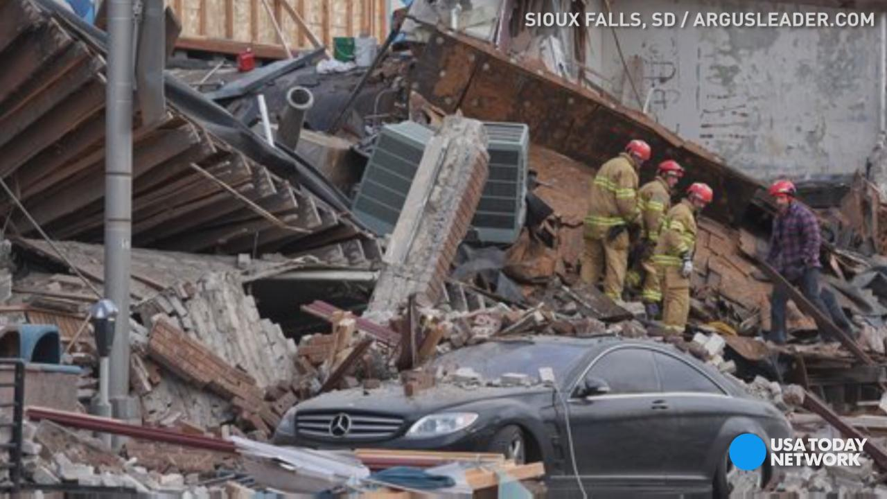 One woman was successfully rescued, along with a dog, after a building collapsed in Sioux Falls, South Dakota.  At least one person remains trapped.