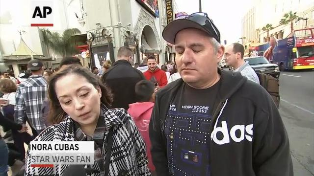 Fans mourn Carrie Fisher on Hollywood Blvd.