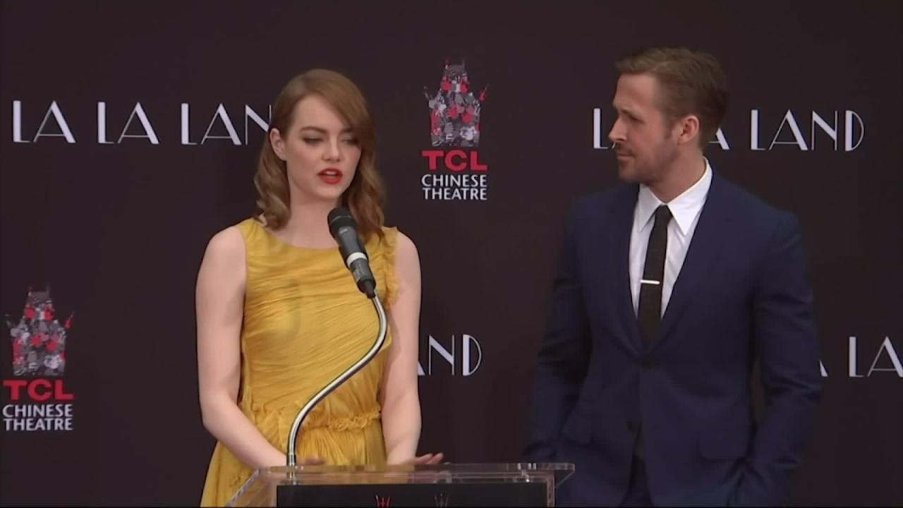 """Ryan Gosling and Emma Stone commemorated their third pairing together in new musical """"La La Land"""" by getting cement hand and footprints at the TLC Chinese Theatre. (Dec. 8)"""