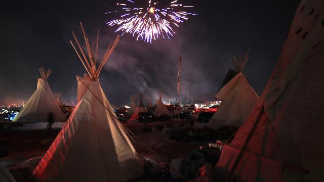 People celebrate around the sacred fire at the Oceti