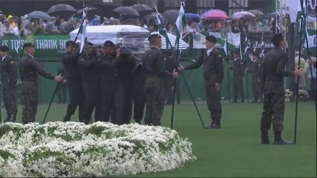 On a rainy that symbolized their grief, 20,000 people filled a stadium to say goodbye to members of the Chapecoense soccer club who died in a plane crash. (Dec. 3)