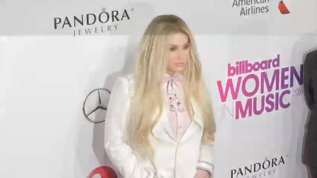 Madonna walked the red carpet Friday in New York to receive her Billboard 'Woman of the Year' honor. Kesha, Shania Twain, and Maren Morris also received honors, but spoke highly of the 'Material Girl' before the event.  (Dec. 9)