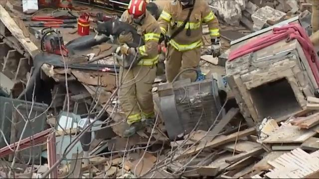 Rescue workers pulled a woman, injured but alive, along with her dog, from the rubble of a building that had collapsed nearly three hours earlier Friday in a South Dakota city. (Dec. 2)