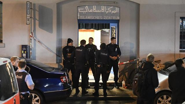 Policemen secure the area in front of the Islamic center