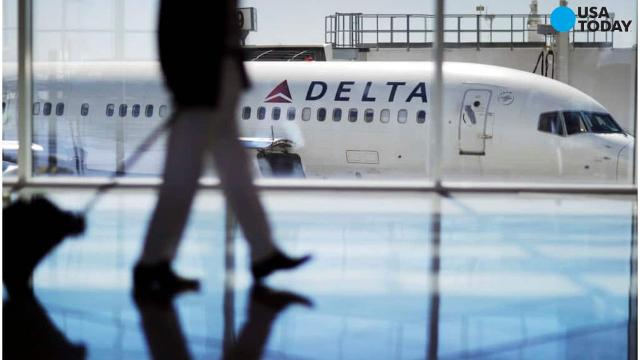 Thousands stranded as Delta hit by glitch – and Trump