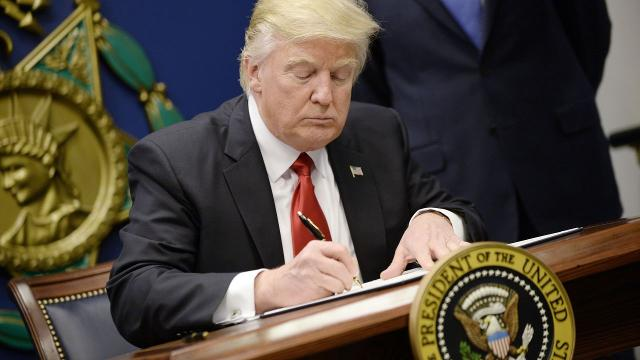 Trump signs two new executive orders on military, refugees