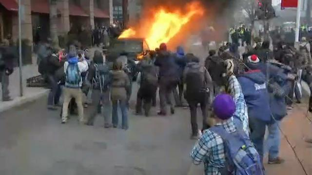 At least one vehicle was set on fire as protests escalated in downtown Washington. (Jan. 20)