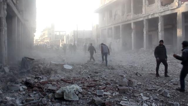 Civilians and members of the civil defence cleared the debris of destroyed buildings following a reported airstrike Thursday by government forces in the Syrian town of Binnish, on the outskirts of Idlib.  Video provided by AFP