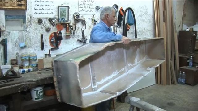 In a tiny workshop in Lebanon's Tripoli, coffin maker Michel Homsi takes a drag on a cigarette, surrounded by his carefully crafted handiwork. He hasn't sold one of his handmade wooden caskets in a year, due to competition from machine-made coffins but also to dwindling numbers of Christians in the northern port city. Video provided by AFP
