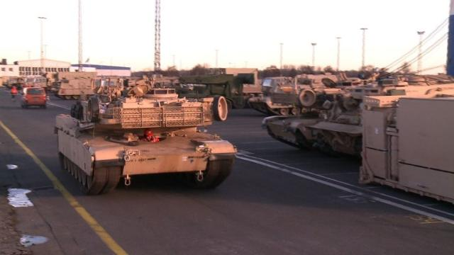 """US soldiers and military equipment arrive in the German city of Bremerhaven ahead of operation """"Atlantic Resolve"""", a range of military exercises by major NATO forces in Eastern Europe to reassure Russia's nervous neighbors in the Baltic. Video provided by AFP"""