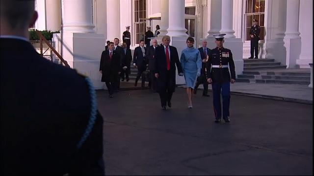 President Donald Trump, Vice President Mike Pence and their families arrive at the reviewing stand near the White House to watch the inaugural parade. (Jan. 20)