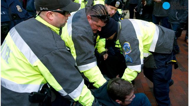 Protesters squared off with police in Washington as fellow Trump opponents demonstrated around the country.